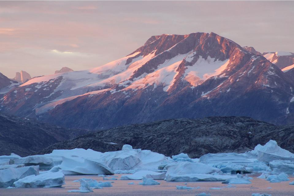 Greenland's dramatic peaks plunge into a sea choked with icebergs broken from the vast ice sheet.