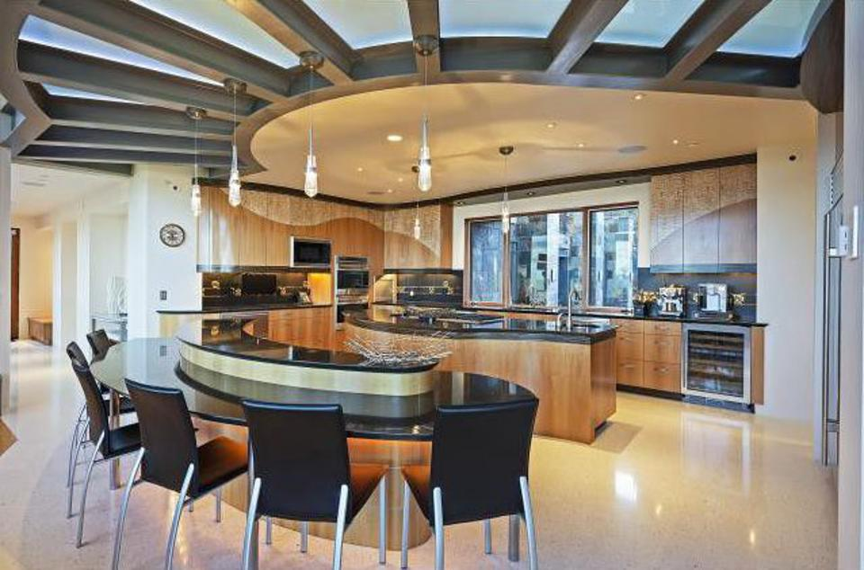 The home features numerous high-end finishes, such as Italian marble and bamboo flooring, granite countertops, Swiss pearwood and Macassar ebony veneer cabinets.