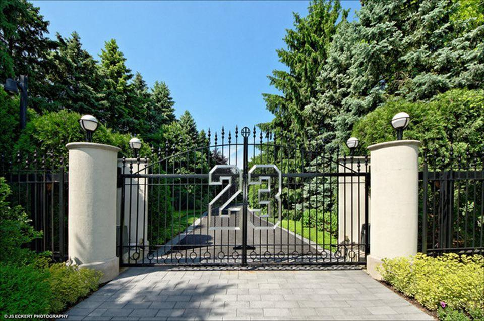 Exterior gate leading to Michael Jordan's Highland Park home, which has been on the market for over seven years.