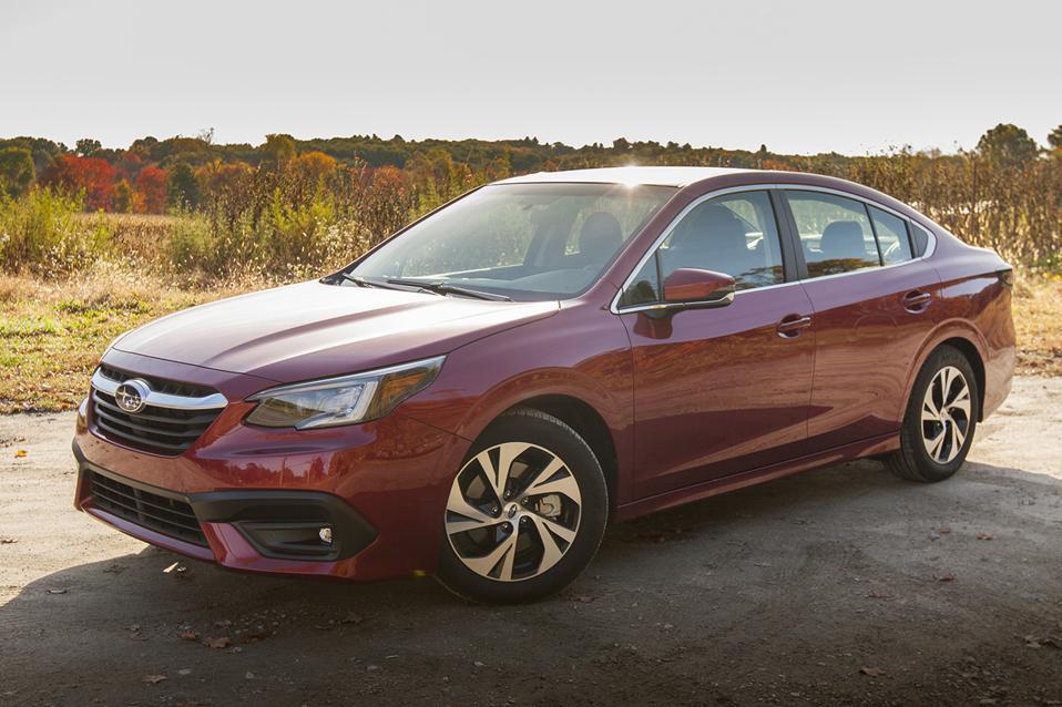 2020 Subaru Legacy 2.5i Premium in red in a New England autumn setting
