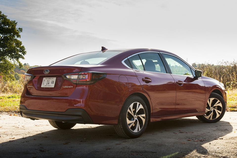 2020 Subaru Legacy 2.5i Premium rear view in red in a New England autumn setting