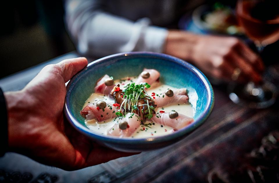 Tangy Peruvian-inspired ceviche in creamy coconut sauce at Coya restaurant Paris