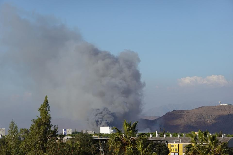 Black smoke rises over fire