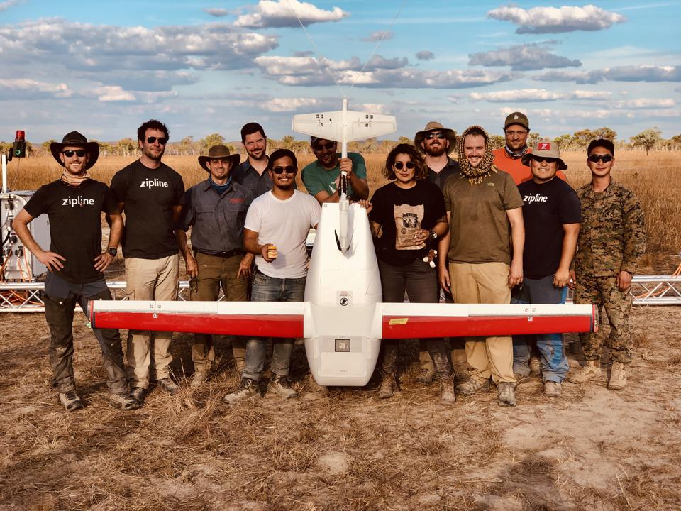 Zipline contractors posing with drone in Australia.