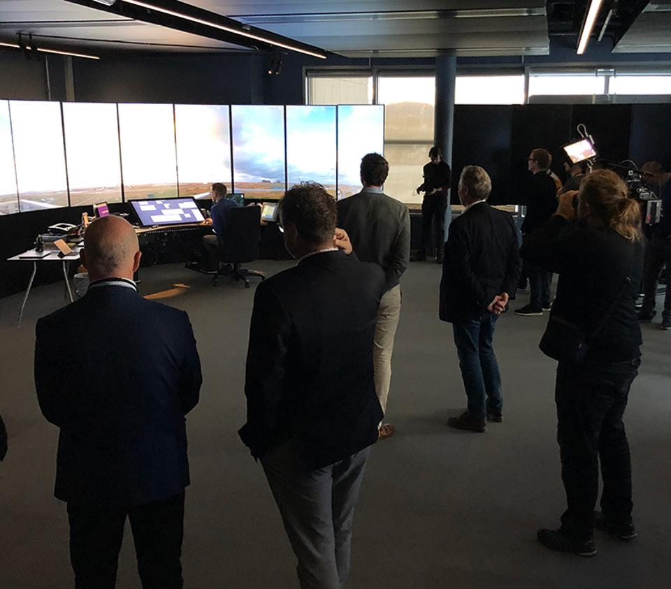 Guests watch on over the first flight to be handled at the new Bodø virtual control tower