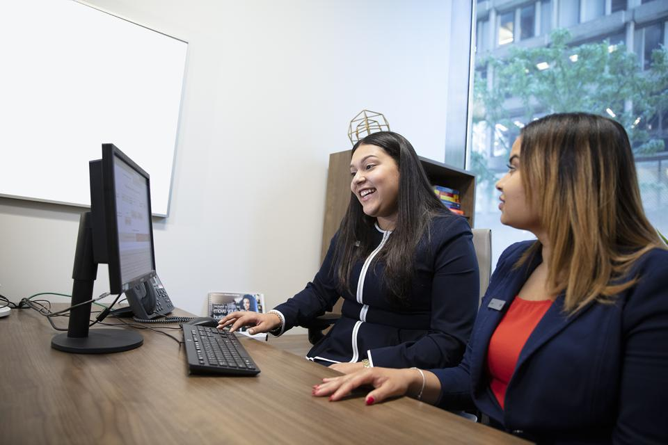 two women looking at a computer screen