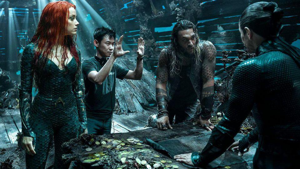 """(L-R) AMBER HEARD, DIRECTOR JAMES WAN, JASON MOMOA AND WILLEM DAFOE ON THE SET OF WARNER BROS. PICTURES' ACTION ADVENTURE """"AQUAMAN″"""