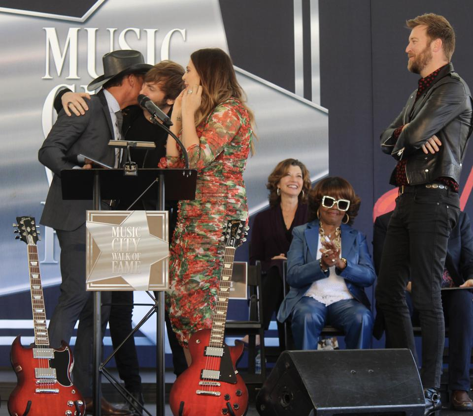 Members of Lady Antebellum with Tim McGraw at Walk of Fame Induction Ceremony