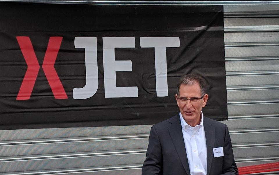 Hanan Gothait prepares to cut the ribbon at the XJet Additive Manufacturing Center, October 2018