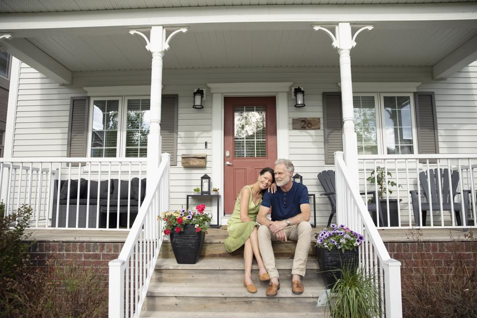 Affectionate senior couple relaxing on front stoop