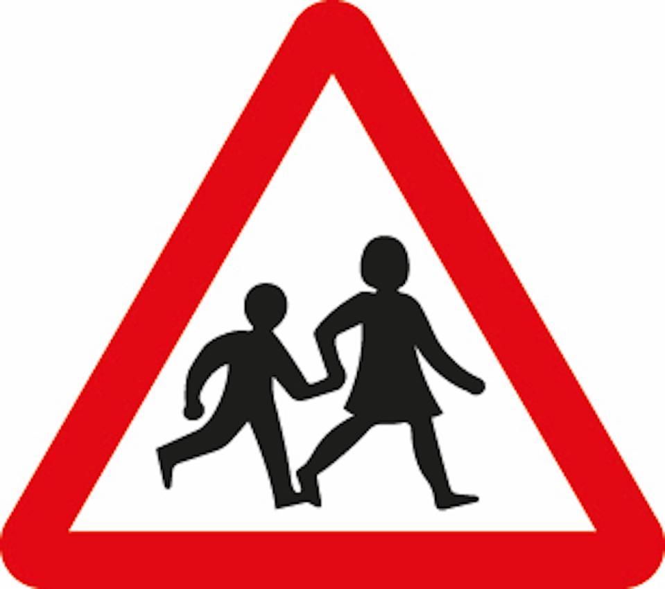 Margaret Calvert's children crossing iconic signage