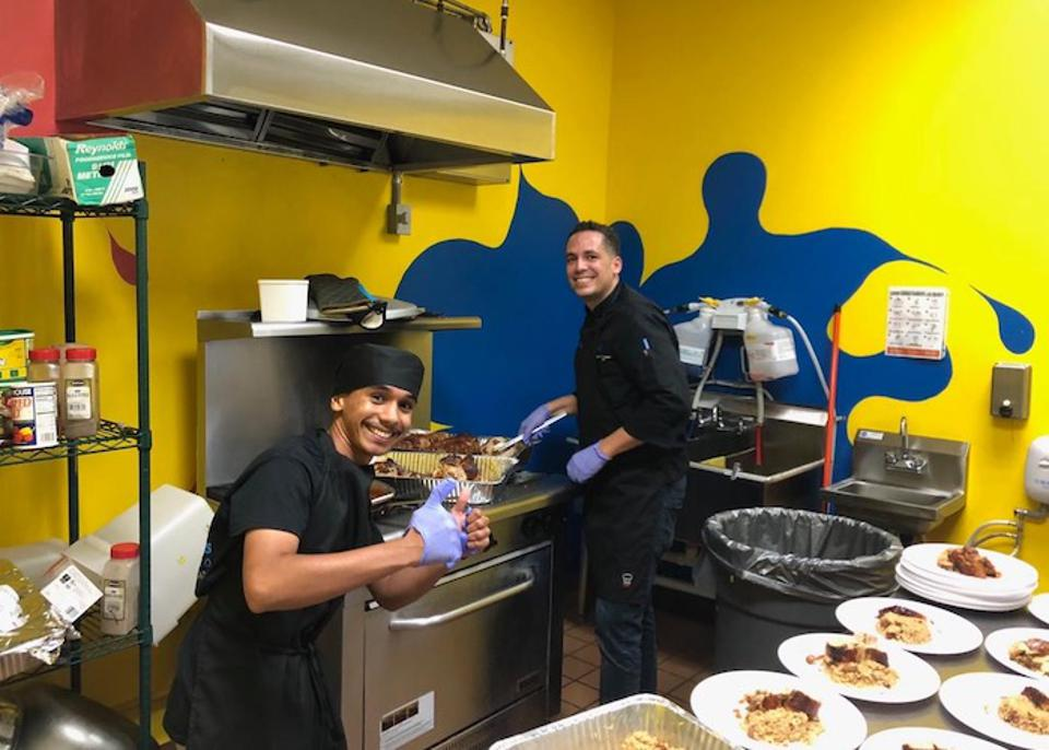 Seventeen-year-old Bryan (left) learned how much he enjoys cooking after he began working with Chef David Ortiz in the kitchen of the Boys & Girls Clubs of Puerto Rico in Isabela.