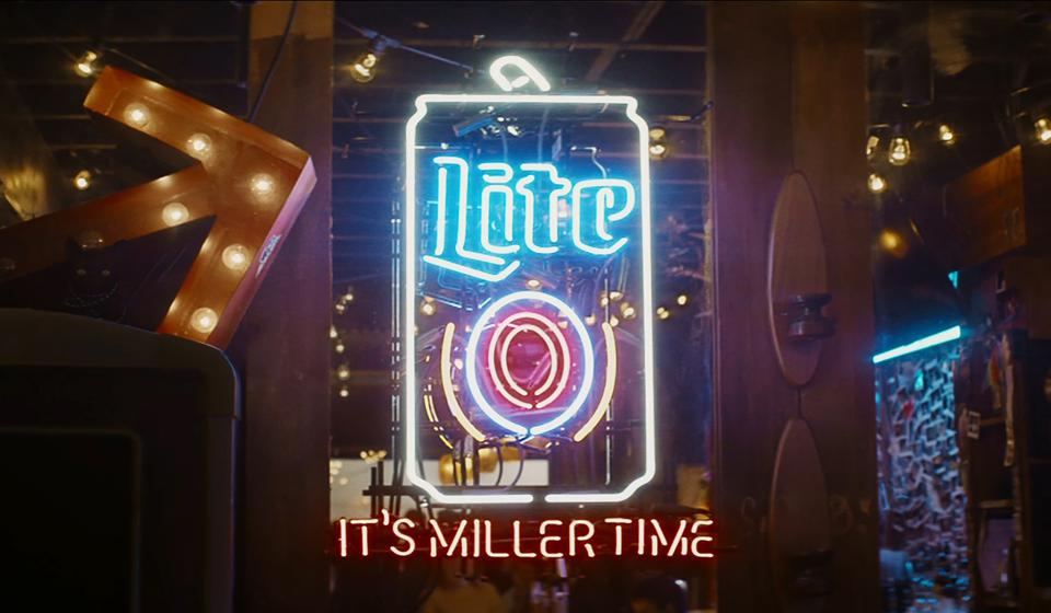 neon light in a bar with it's miller time