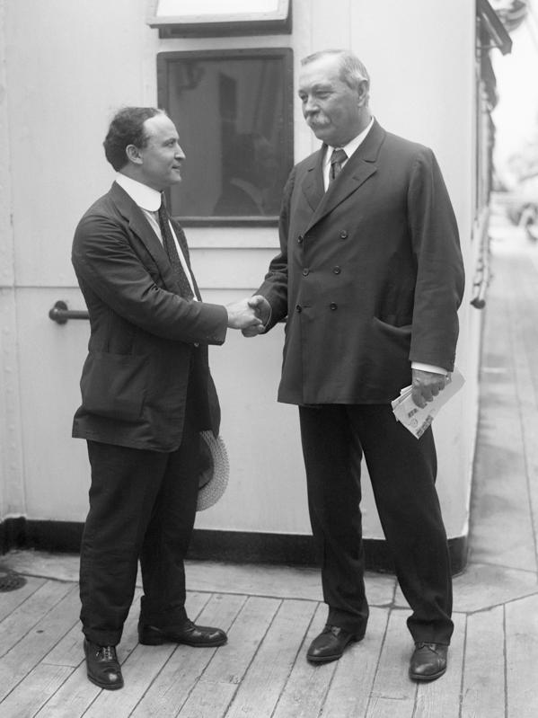 Harry Houdini and Sir Arthur Conan Doyle Shake Hands