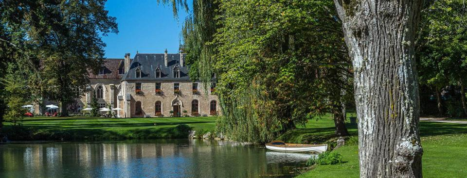 12th century Cistercian Abbaye de la Bussiere and its lake, willow and oak trees