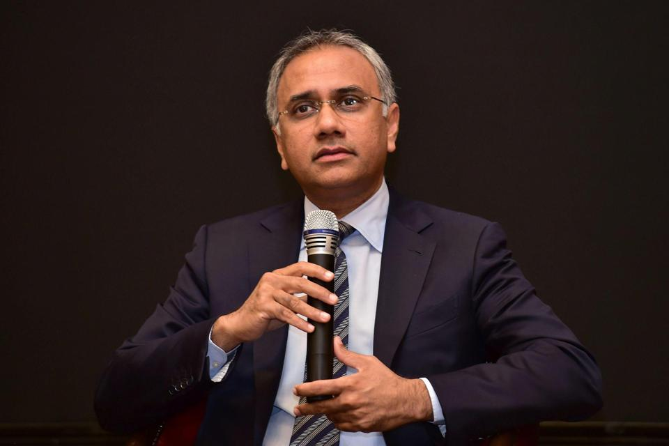 Salil Parekh speaks during a press conference.