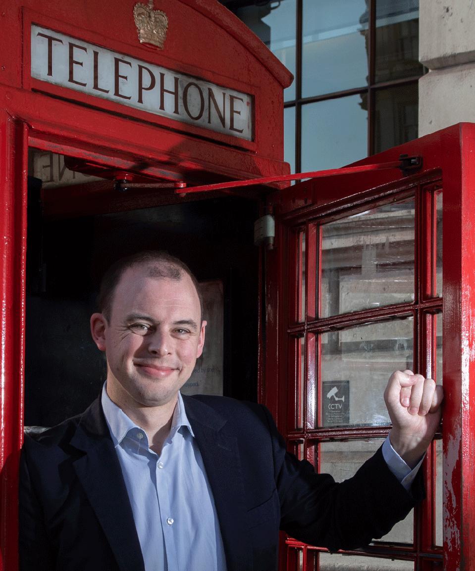 Matt Warman in a phone box.