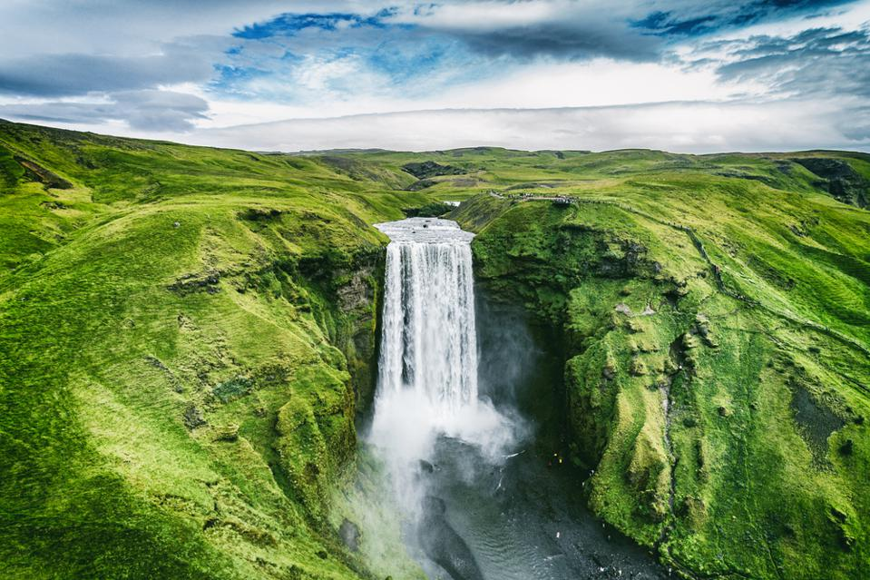 Tourists in Iceland love Skógafoss.