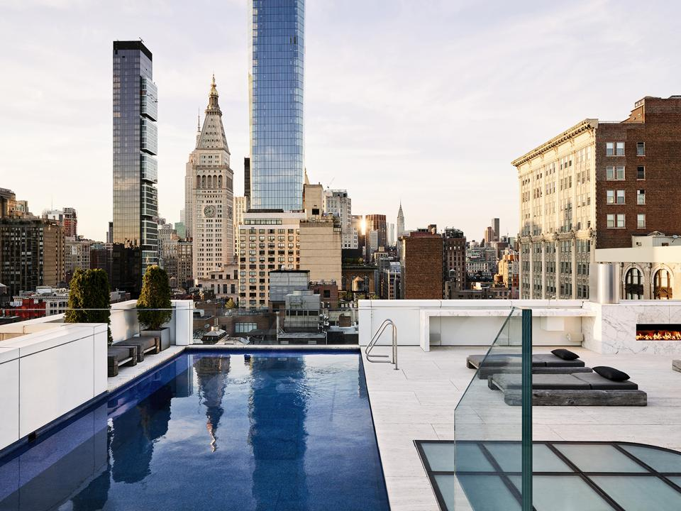 This $30 Million Flatiron Penthouse Boasts A Private Rooftop Pool And A Two-Story Wall Of Swiss Alps Marble