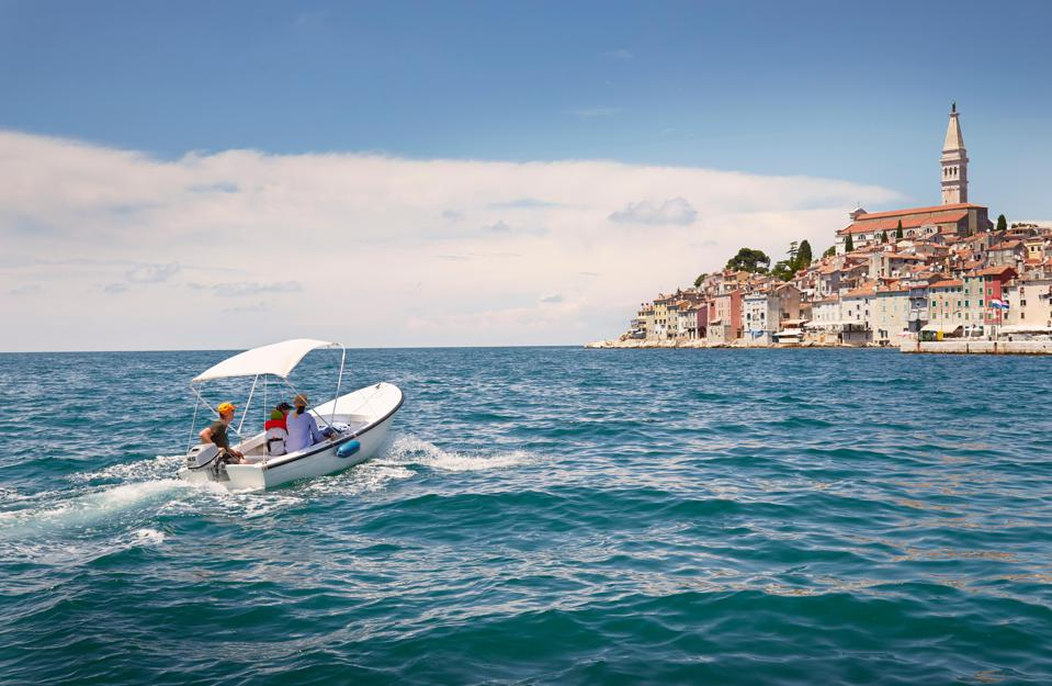 Family with two children in motor boat, Rovinj, Istria Peninsula, Croatia