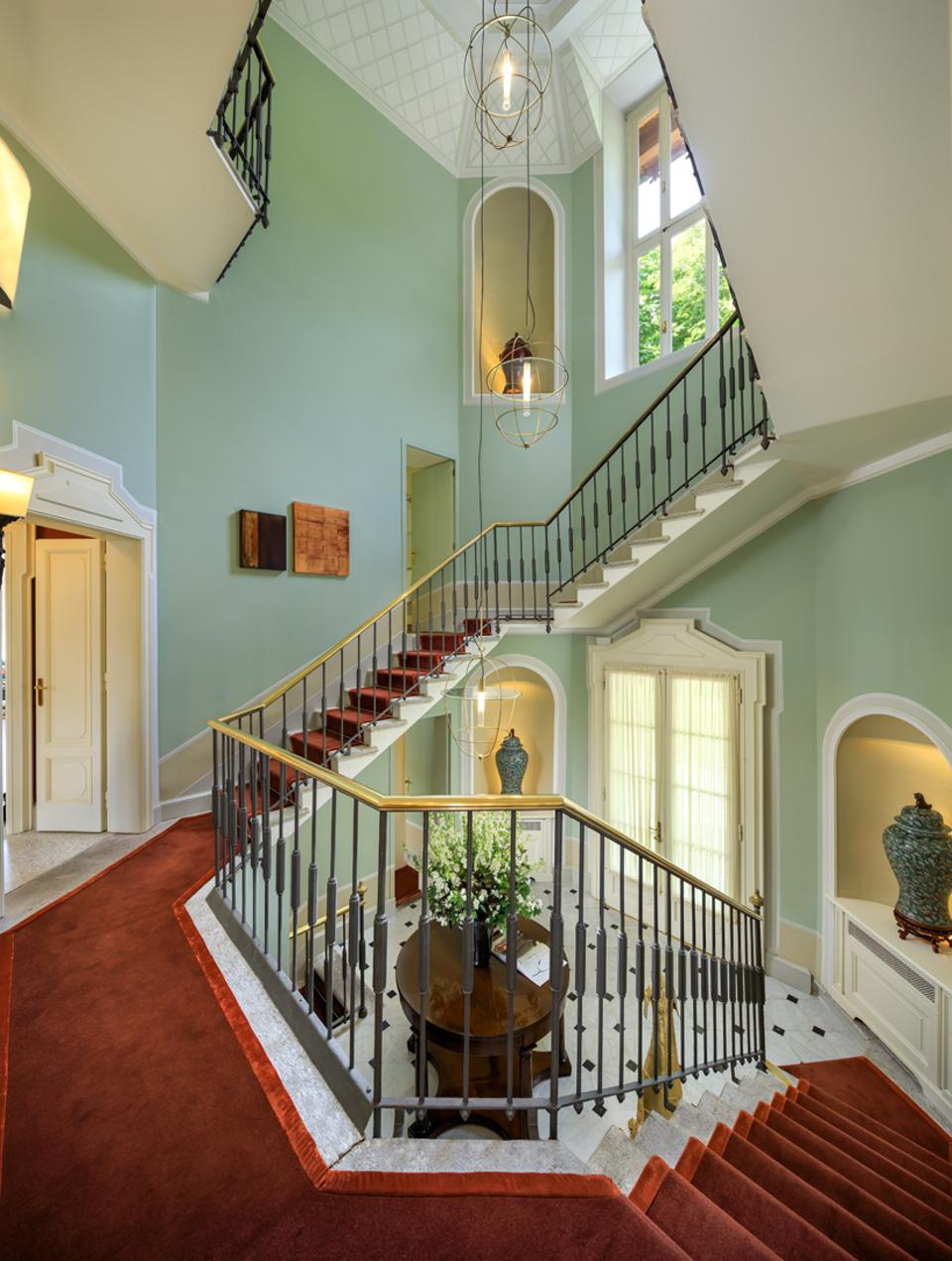 Villa Cima's grand staircase leads up and down to bedrooms and living spaces.