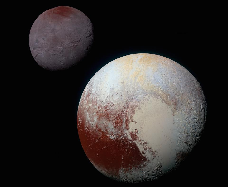 This composite of enhanced color images of Pluto (lower right) and its moon Charon (upper left), was taken by NASA's New Horizons spacecraft as it passed through the Pluto system on July 14, 2015.
