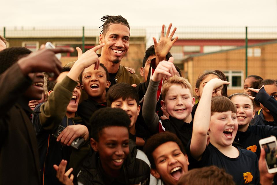 Chris Smalling with children as part of the Football Beyond Borders charity.