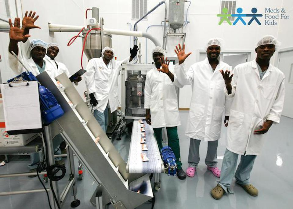 Workers at the state-of-the-art Meds & Food for Kids factory just outside Cap Haïtien, Haiti make 4 million kilograms of Ready-to-Use Therapeutic Food a year.