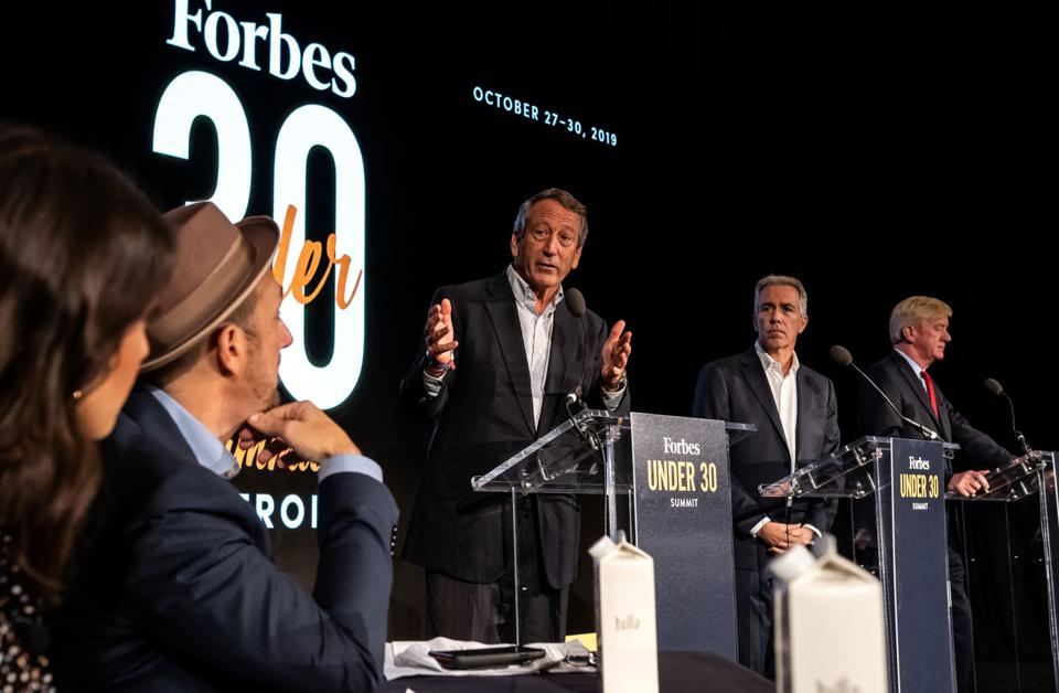 Mark Sanford, Joe Walsh and Bill Weld debate each other at the Forbes 30 Under 30 Summit Monday.