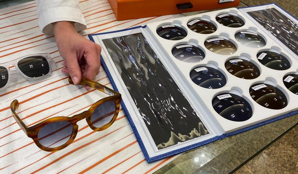 Customising sunglasses at Ottica Carrero.