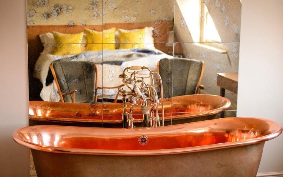 A decadent copper bath tub at The Bingham Riverhouse hotel in Richmond, London
