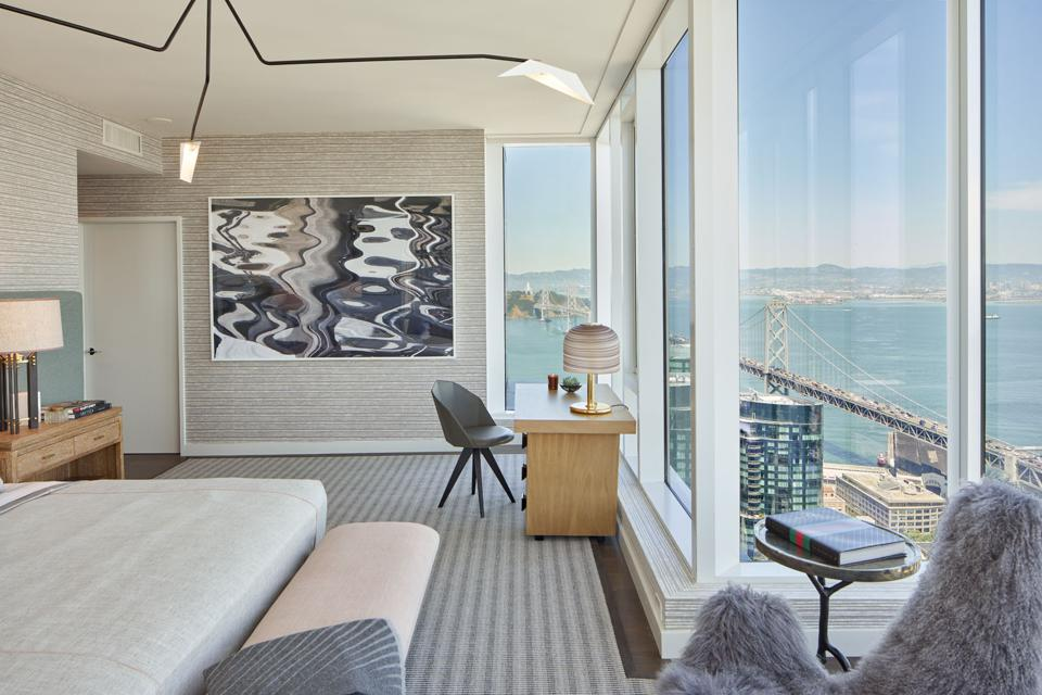 The Avery, Penthouse Master Bedroom featuring large-scale artwork curated by Wendi Norris Gallery.
