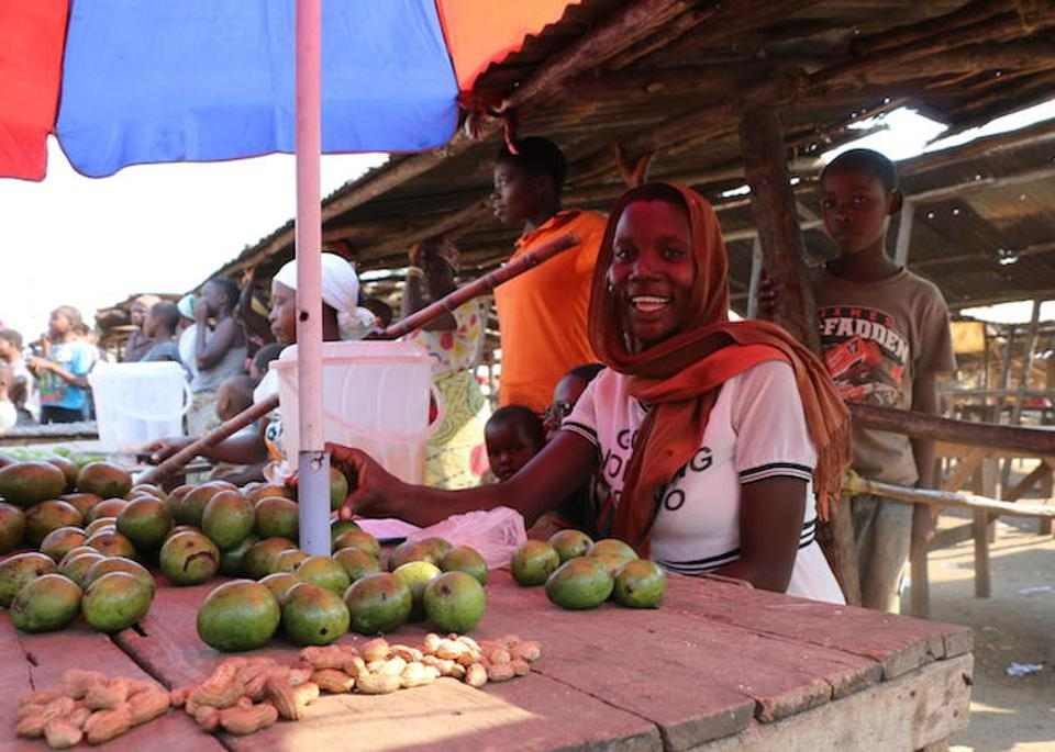 Estelle Nikoyagize, 23, sells mangoes in the market in Gatumba, Burundi, interacting daily with suppliers from neighboring Democratic Republic of Congo, where health workers have been battling an Ebola outbreak for more than a year.