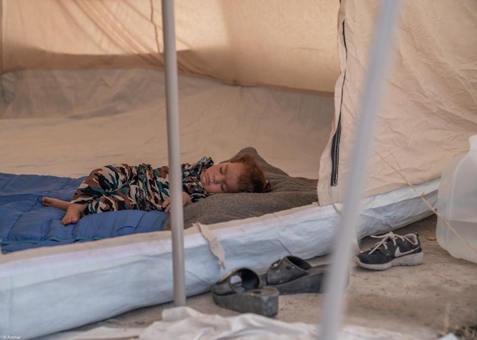 Darya, a 2-year-old from Qamishli in northeastern Syria, sleeps alone in a tent in the Barderash refugee camp in Akre, Iraq on October 21, 2019.