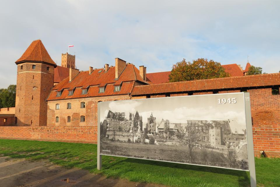 Malbork Castle with an image showing the destruction during WWII