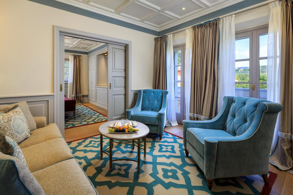 The colorful first-floor Limonaia suites overlook the Arno River.