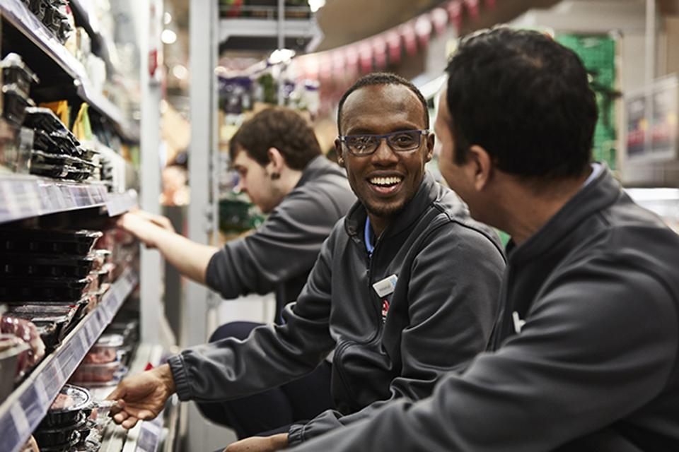Workers restock shelves in one of Britain's Co-op food stores.