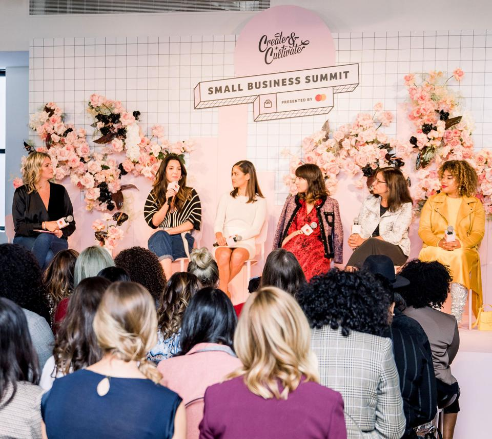 A panel of women speaking onstage at the Create & Cultivate Small Business Summit