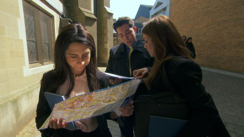 the apprentice 2019 episode 5: candidates look at a map.