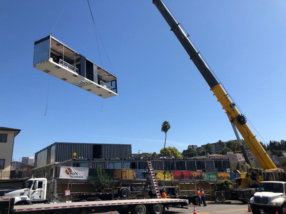 The 84-unit development was unveiled with a viewing event where multiple modular sections were lifted into place, demonstrating the efficiency of construction.