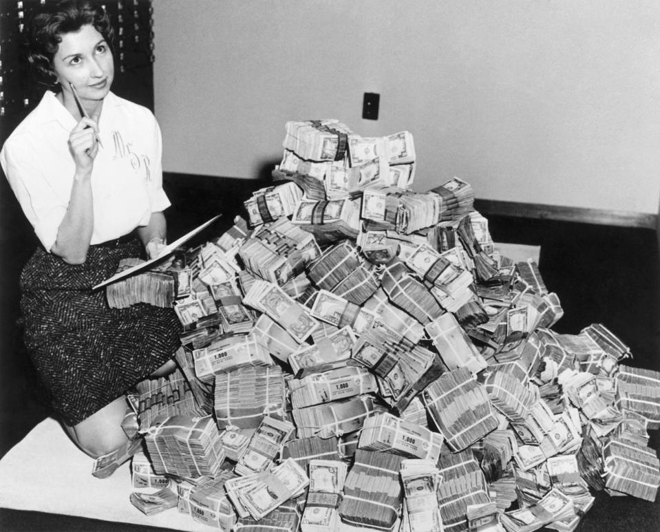 Bank Employee Sitting by a Million Dollars in Cash