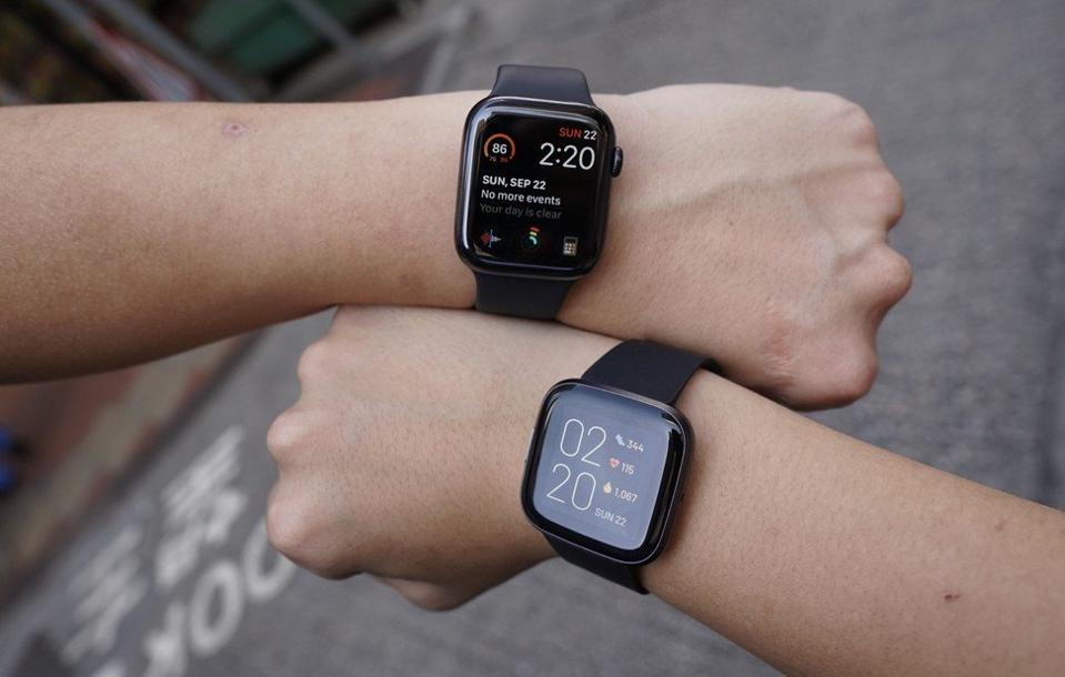 The Versa 2 and the Apple Watch 5.