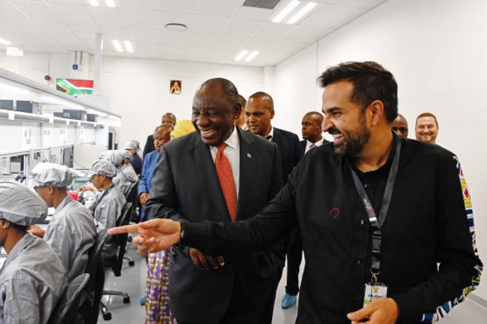 Mara Group's CEO Ashish Thakkar (right) giving South African President Cyril Ramaphosa a tour of the group's new smartphone manufacturing plant at Durban's Dube TradePort SEZ.
