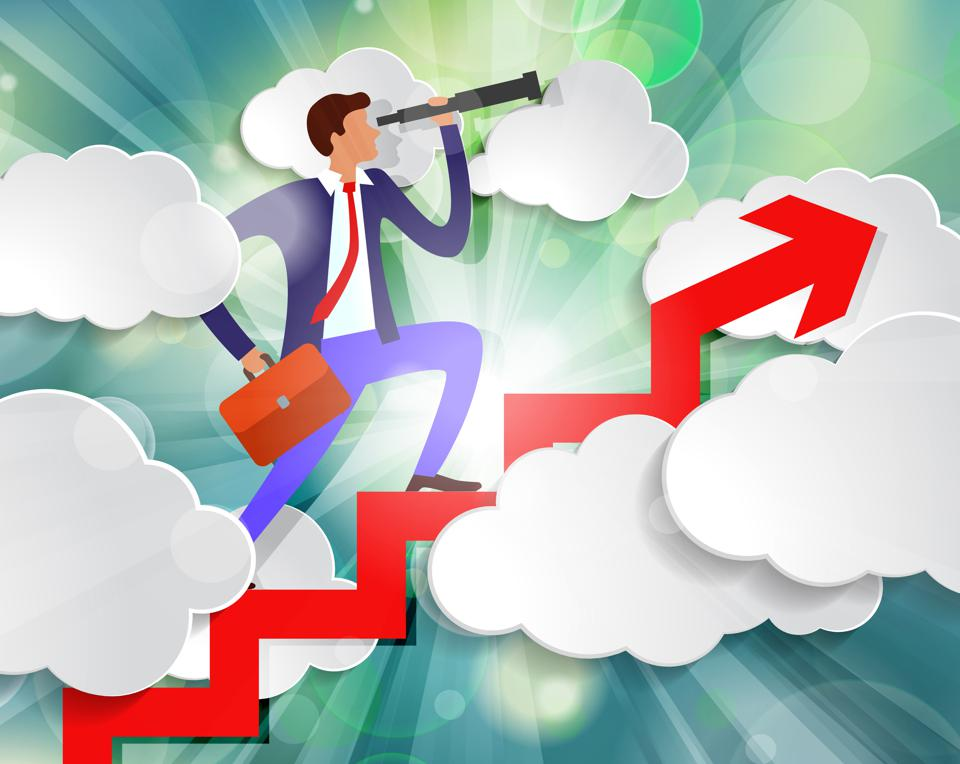 business man climbing scale through the clouds