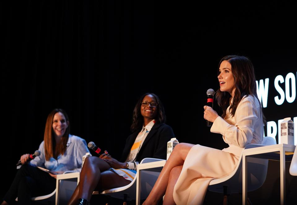 Moira Forbes (left) sits with Nia Batts (center) and Sophia Bush (right) at the Under 30 Summit in Detroit on October 27.