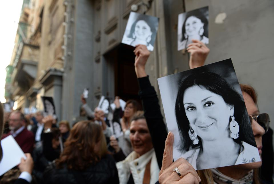People leave a mass in memory of murdered journalist Daphne Caruana Galizia