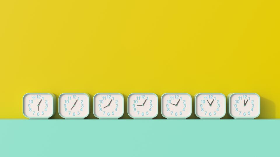 3D rendering, Row of alarm clocks, showing different times