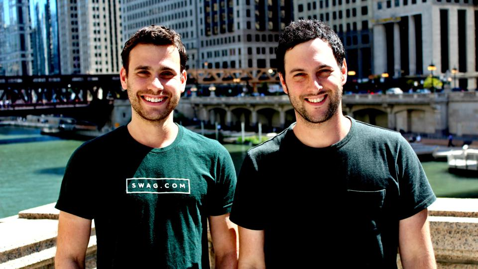 A photograph of Swag.com founders Josh Orbach and Jeremy Parker standing in New York City.
