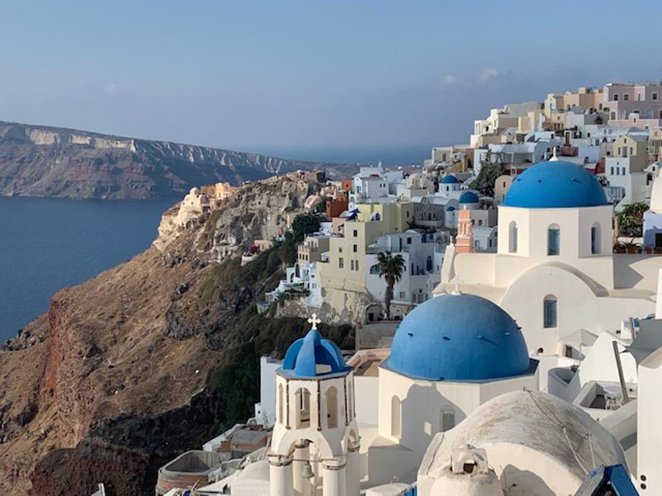 The town of Fira and its blue domed churches