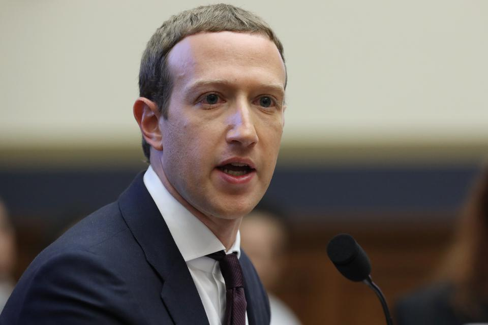 Facebook CEO Mark Zuckerberg testifies before the House Financial Services Committee about his company's proposed cryptocurrency Libra.